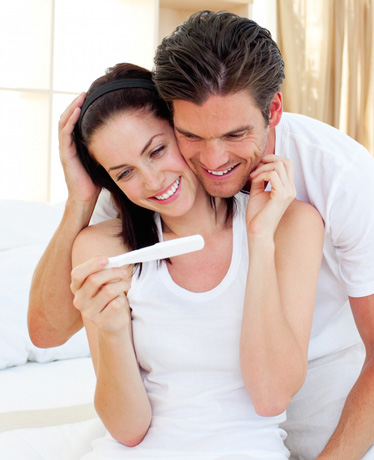 Couple Reads Results of a Positive Pregnancy Test