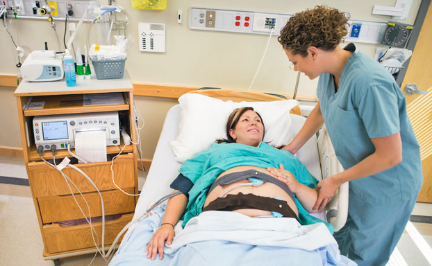 Woman Undergoing Non-Stress Test with Monitor Belt for Fetal Surveillance