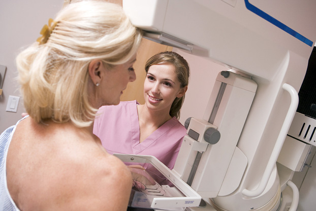 Nurse Assisting Patient with Breast Health Mammogram