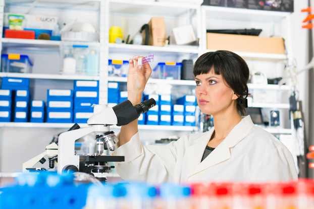 Scientist Analyzing Lab Results from Pap Smear Test