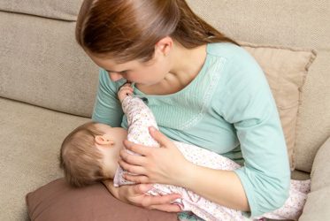 young-mother-breastfeeding-baby