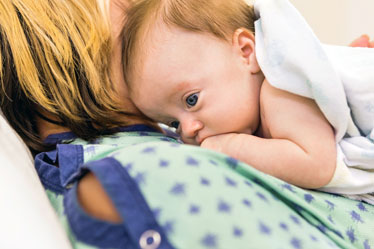 New Mother in Hospital with Newborn Infant Postpartum Care