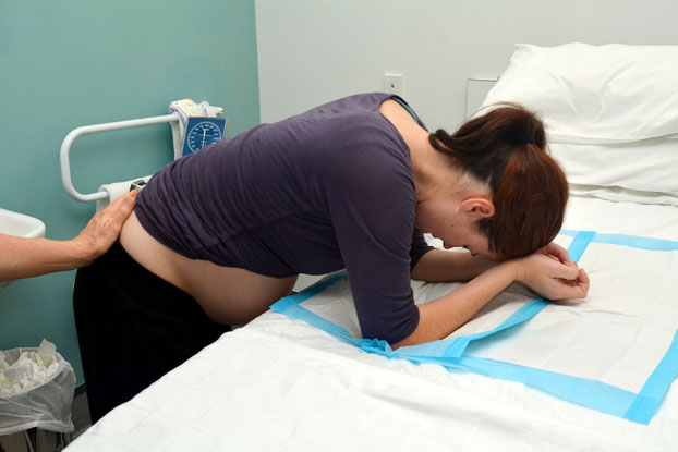 Pregnant Woman Experiencing Contractions & Labor Pains