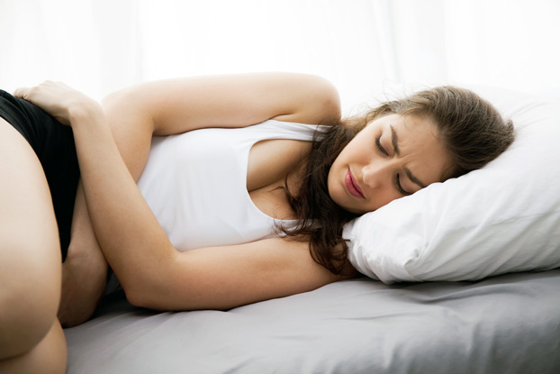 Young Woman Experiencing PMS Symptoms During Menstrual Period